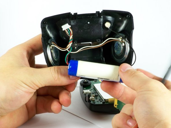 Image 2/3: You may need to use a soldering iron and tongs to remove battery from the speakers.