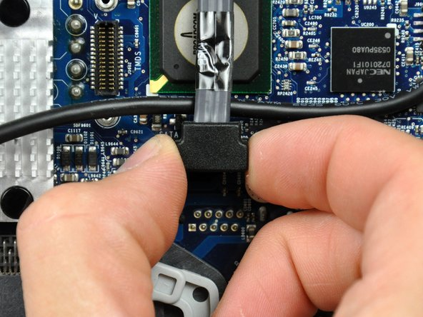 Disconnect the hard drive data cable connector from the logic board by pulling it straight up from its socket.