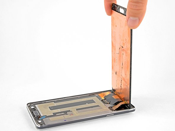 You may want to support the display with something, such as the box the phone came in, while you disconnect the display and digitizer cables.