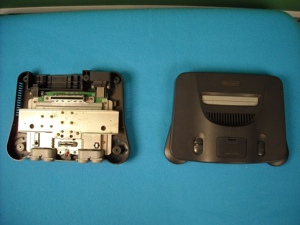 Image 2/2: Flip the console cartridge-side down and remove the six screws using a Phillips screwdriver or gamebit head.
