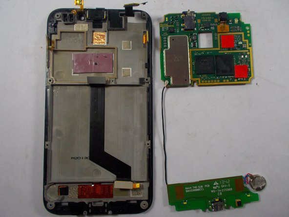 Carefully remove the motherboard from the rest of the phone.