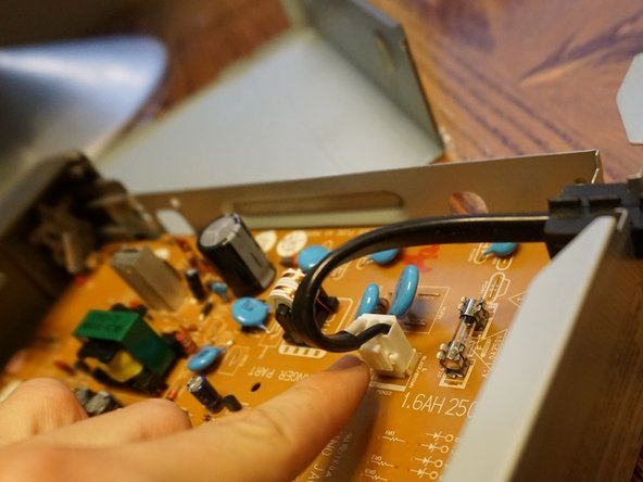 Unplug the power cable from the circuit board, pay attention to the tab on the side, press it down and pull