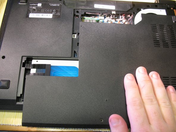 Slide the panel towards the front of the computer; it will come off easily.