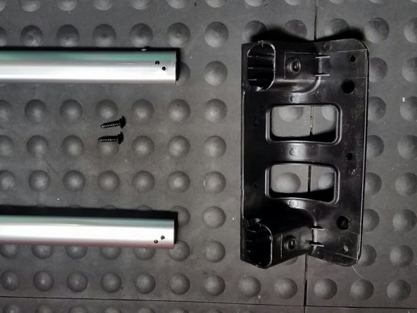 Once both screws are removed, pull off the black piece on the end.