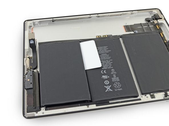 Leave this card in place to prevent the adhesive from resetting while you loosen the other battery cells.