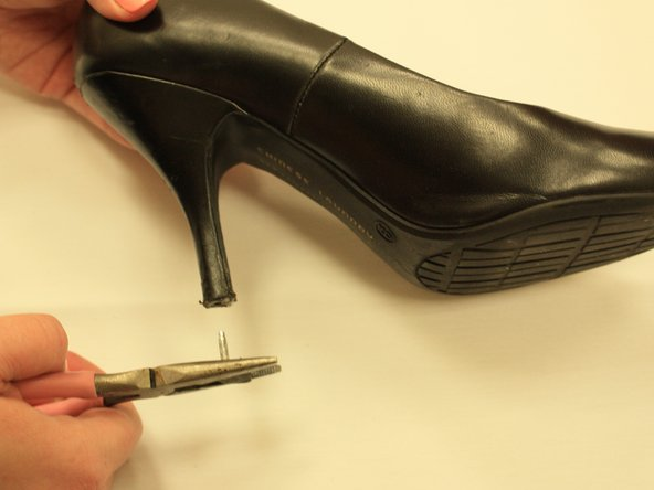 Carefully remove the heel tip with the pliers by twisting and pulling it out. Most can be turned counter clockwise to remove. Be careful not to pull only the rubber off.