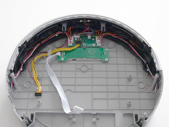 Make sure all the wires are tucked behind the black hooks lining the inside of the bumper before closing bObi Pet.