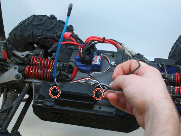 Image 1/3: Remove the two 7mm long screws retaining the largest wiring cover with the 2mm hex key.