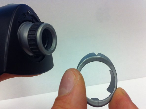 Gently remove top (silver) ring of lens casing with your fingers.