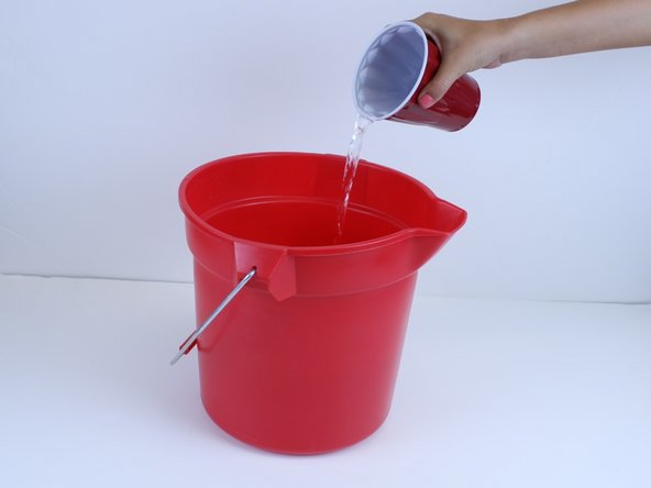 Fill a bucket with room temperature water.
