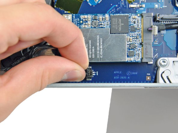 Disconnect the HDD fan and power button from the logic board by pulling their connectors straight up off the sockets on the logic board.
