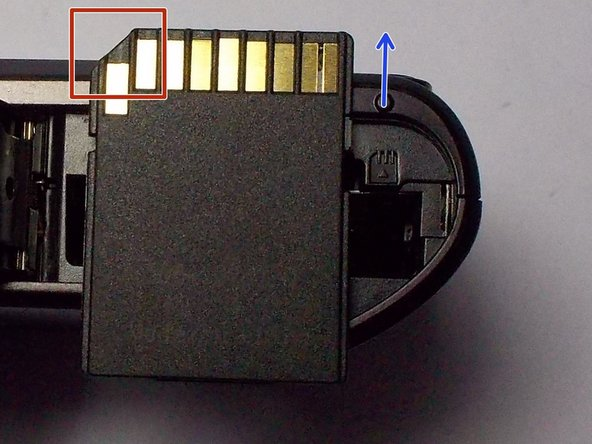 The slanted corner of the memory card should be facing to the left.
