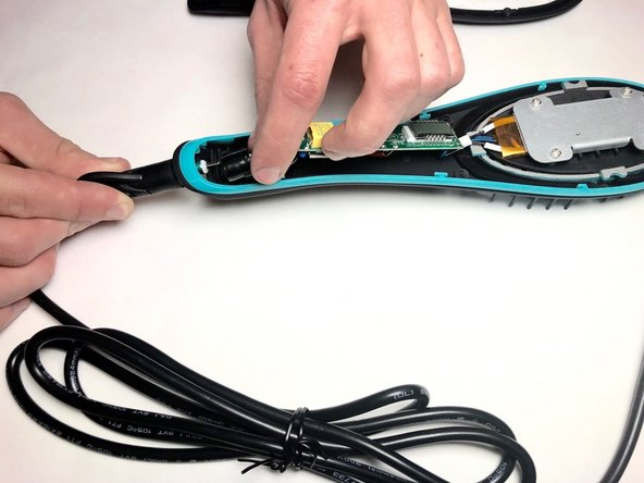 Unplug the power cord from the insert inside of the brush.