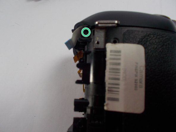 Remove the two screws placed on the right and left sides of the camera.