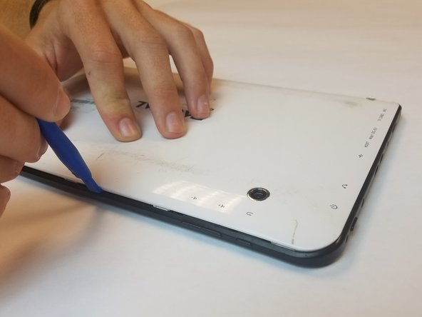 Carefully remove the back cover by using a plastic opening tool, moving all the way around the perimeter of the tablet.