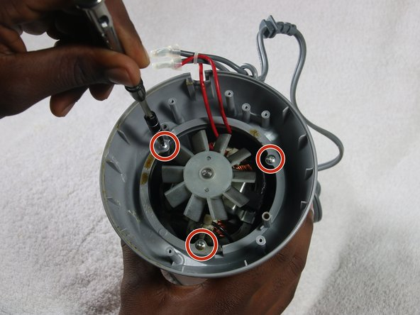 Unscrew the three 1 cm screws on the device circled on the screws pictures using the #1 Philips Head Screwdriver.