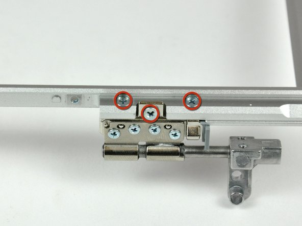 Image 1/2: Remove the left clutch hinge and set it aside.
