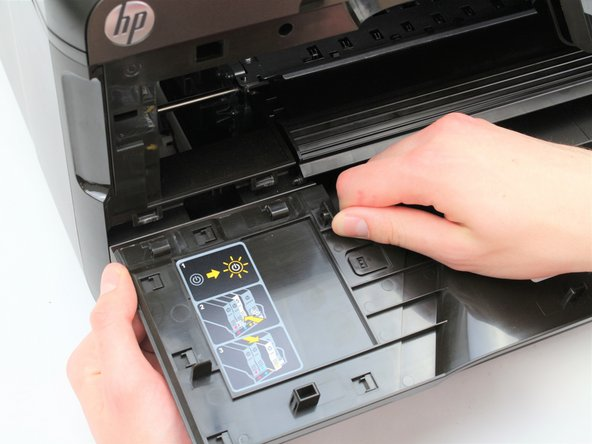 Pull the front panel door away from the printer toward you.