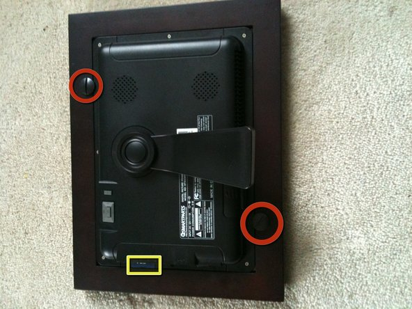 Image 1/3: Remove the peg screws holding the electronic photo unit to the display.