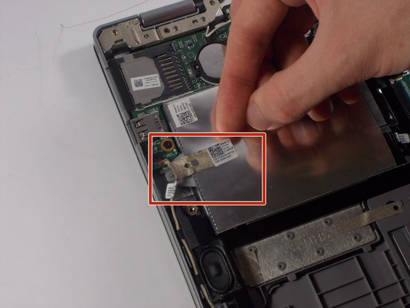 Remove the tape attached to the Solid State Drive by simply pulling them off with fingers.