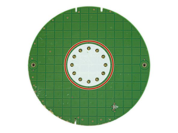 This round green grid is half of an array of capacitors—with the other half buried in another, deeper PCB layer. By measuring the total capacitance of each row and column, the controller can detect when—and pinpoint where—your finger is modifying the capacity of the grid through capacitative coupling. Science!