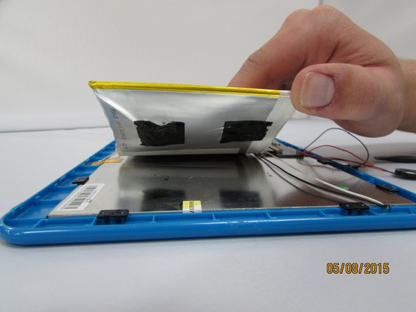 Image 2/3: The battery is held down by very strong adhesive.