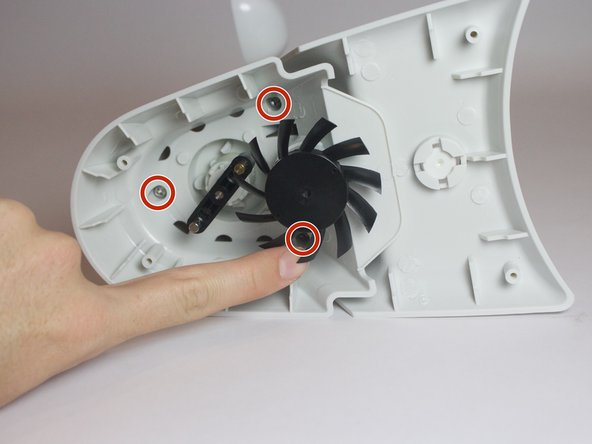Remove the three 0.8cm screws inside of the solar panel housing.