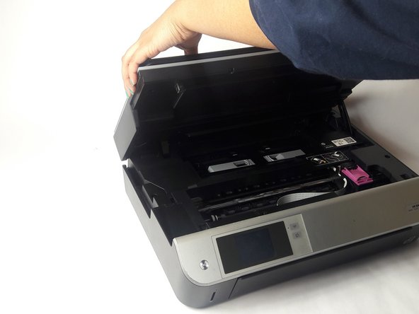 Open the the printer by lifting the top section. Make sure you're lifting from the lowest portion of the scanner section.