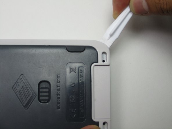 Image 1/3: Use the Plastic Prying Tool to carefully pry the back plate out at the bottom right corner.