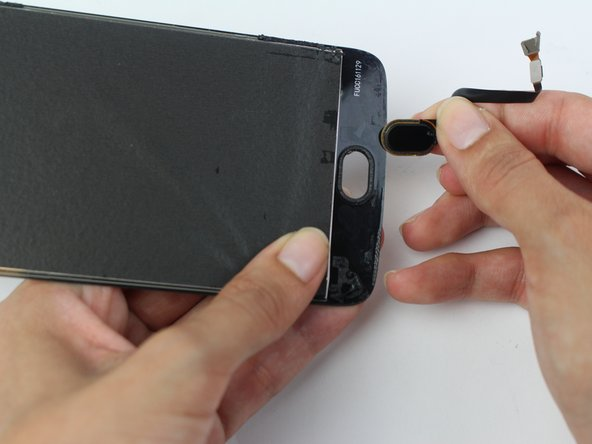 Remove the fingerprint sensor button from the screen by pushing it out with your fingers.