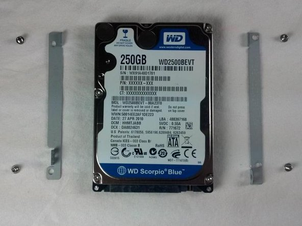 The hard drive is now fully removed and ready to be replaced.