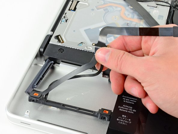 Lift the hard drive and IR sensor assembly out of the upper case.