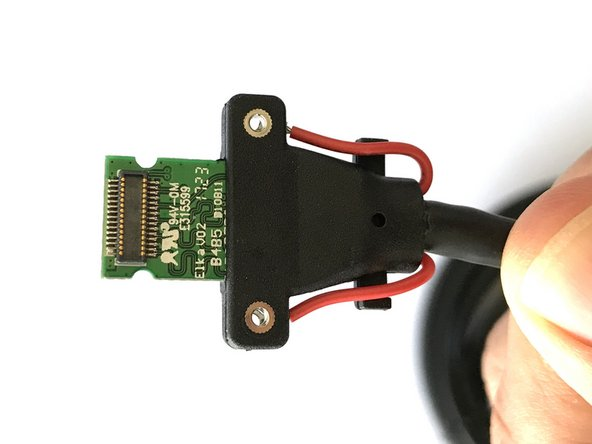 Instead of plugging directly into the HMD, the proprietary connector plugs into a receptacle which is attached to an embedded connector (shown on the PCB in steps nine and ten).