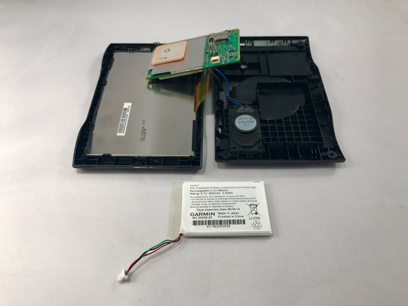 Image 2/2: You might need to use additional force when prying because there is adhesive glue on the back of the battery.