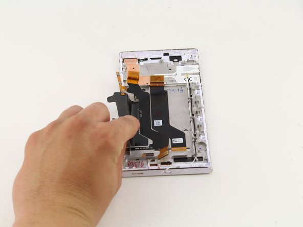 Lift up with your hands to remove the two black pieces of tape that hold down the battery.