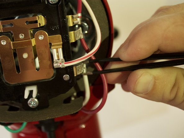 Using pliers or tweezers, remove the connectors attached to the speed control plate.