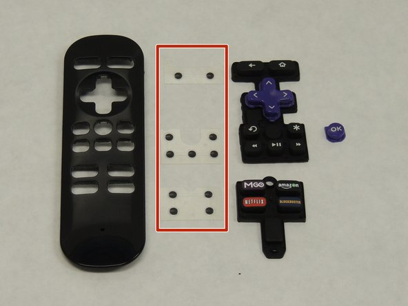 First, gently remove the three plastic sheets. Then, remove the button panels from the remote control.