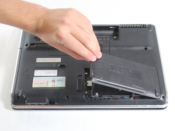 Image 1/2: You may want to use an opening pick under the leftmost edge to pry open the case plate if you have trouble opening the hard drive socket.