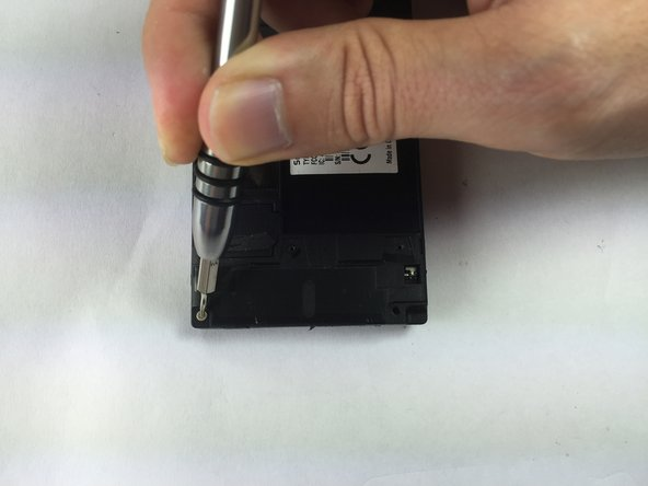 There are two additional screws under the bottom white cover as shown.