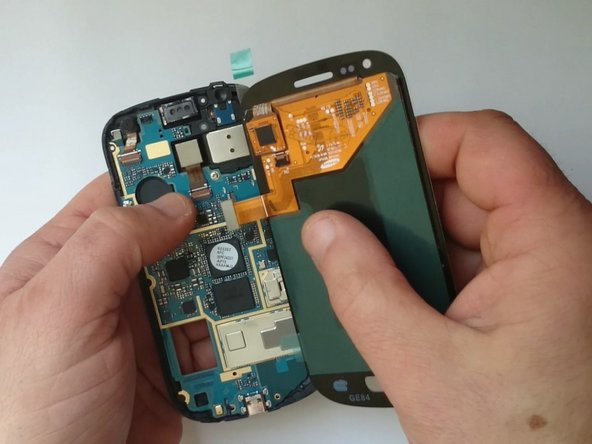 Image 1/3: First connect the Display assembly, grab the phone comfortably and then put the battery.