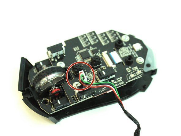 Locate the 5-pin connector on the mouse's motherboard.