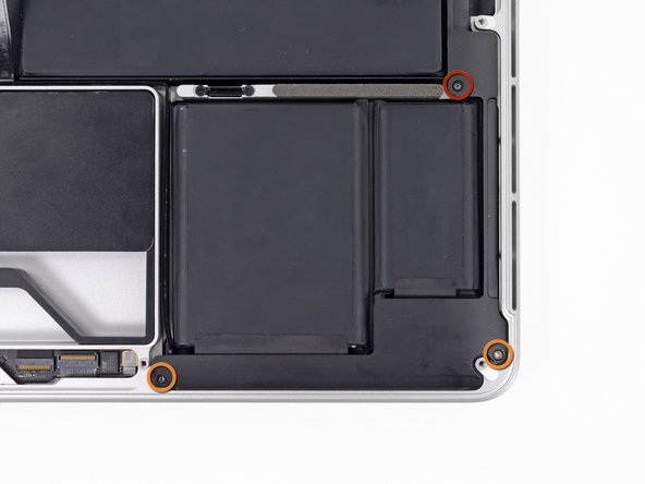 Remove the following screws securing the left speaker to the upper case: