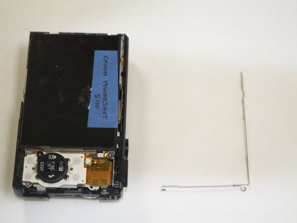 Image 2/2: Remove the other screw at the bottom corner of the camera to make removing the display easier in the next step.