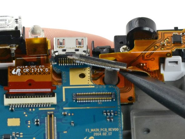 Use a spudger to disconnect the LCD ribbon cable by prying it straight up from the motherboard.