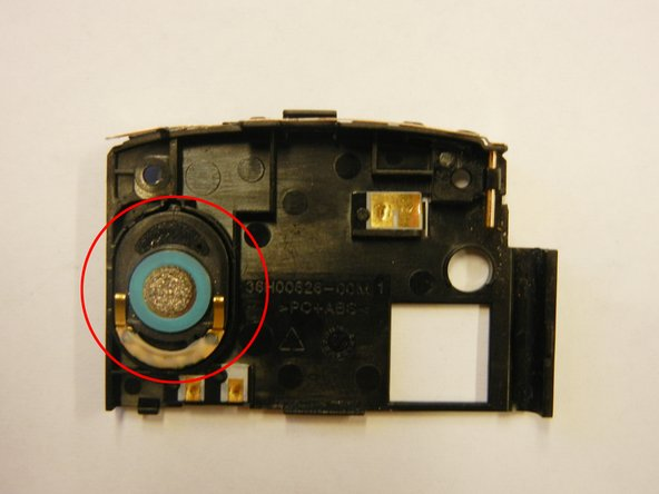 Use the plastic opening tool to remove the speaker.