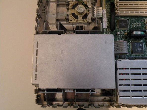"The ""SuperDrive"" is mounted similarly to the hard drive, and positioned right next to it."