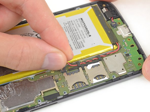 Peel off any tape securing the battery wires, and then push the battery wires towards the battery to de-route them from the black bracket on the motherboard.
