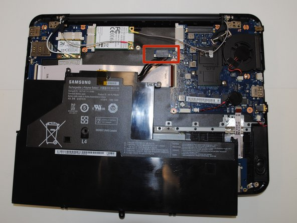 When unscrewed, lift the battery.  There will be a cable connected to the battery.  Detach this cable from the board and remove the battery.