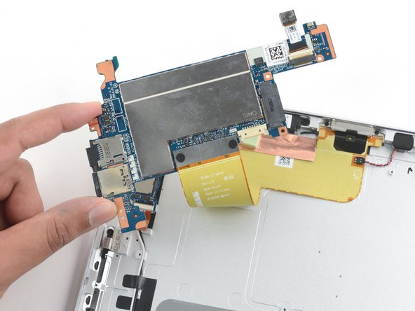 After removing the five screws and three remaining cables connected to the motherboard, we discover there are two cables connected to the back of the board. This is inconvenient and means we need to remove the selfie camera with the main board.