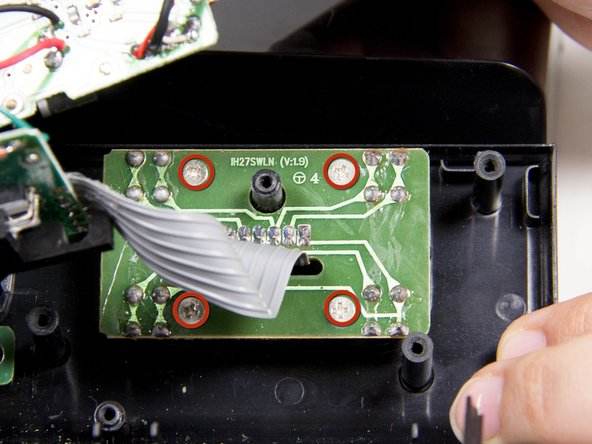 Image 1/1: Carefully lift the main motherboard out of the way of the button control circuit board.